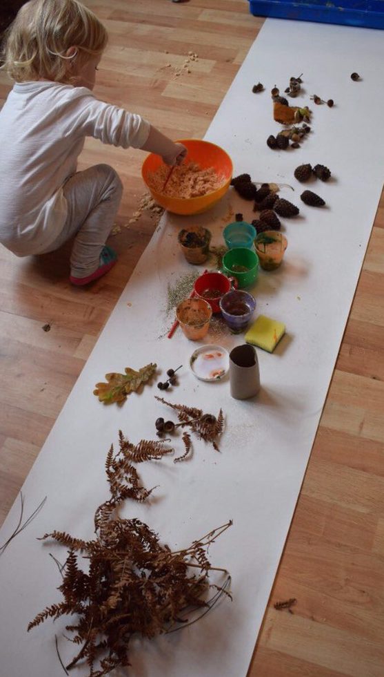 sensory play messy play moon sand fir cones acorns natural treasures texture autumn paints glue glitter toddler rainy day activities